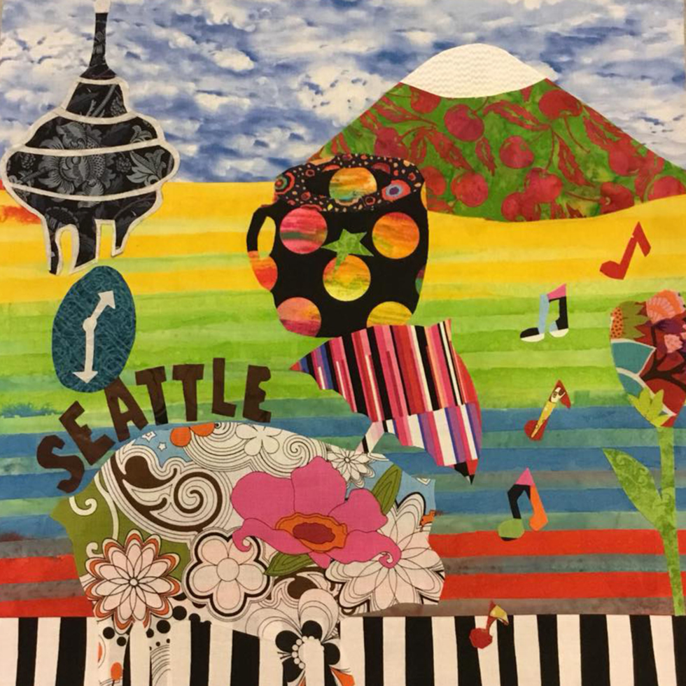 "The ""All That Seattle Jazz"" block created by the Our Fabric Stash team was inspired by the artwork of Leonardo Lanzolla, entitled Seattle Siesta."
